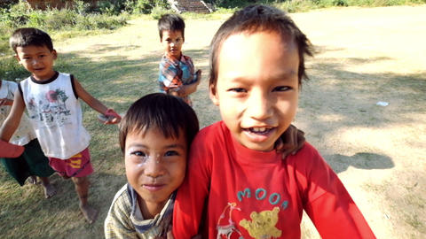 Happy smiling local children posing for camera. Myanmar (Burma) Footage