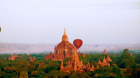 Hot Air Balloons Flying Over Ancient Buddhist Temples At Bagan. Myanmar stock footage