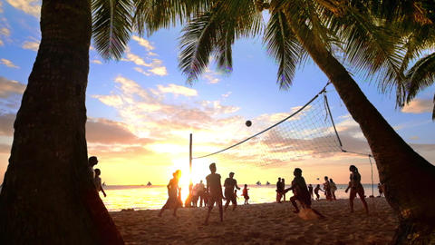 Slow Motion. Sunset Silhouette Of People Playing Volleyball At Tropical Beach Un stock footage