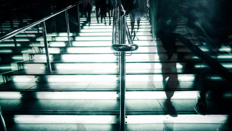 Time Lapse People Silhouettes Moving At Illuminated Stairway stock footage