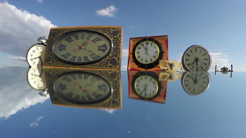 Many various clocks on the mirror beneath the cloudy sky, time lapse 4K Footage