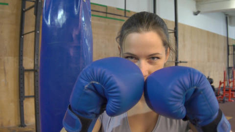 Slow Motion Kickboxing Woman Training Punching Bag In Fitness Studio Footage