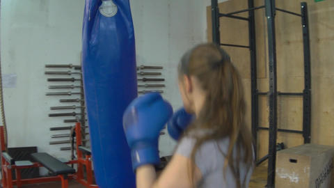 Slow Motion Sports Woman Is Engaged In Boxing, Trains With A Boxing Bag In The F Footage