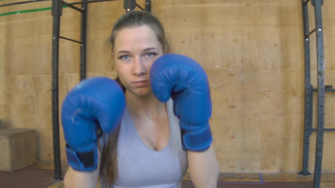 Slow Motion Strong Woman Athlete With Boxing Gloves Footage