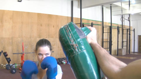 Slow Motion A Young Girl Woman Trainer Holds Boxing Paws For Her Pupils. Back Vi Footage