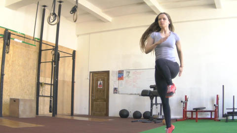 Slow Motion Young Woman Running And Jump Footage
