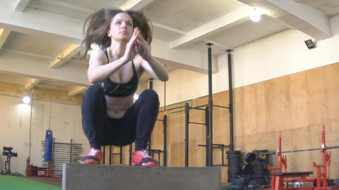 Slow Motion Woman Jumps On Wooden Cube In The Gym Footage