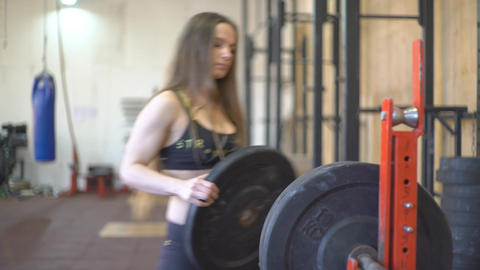 Girl Athlete Puts Weight On The Barbell Live Action