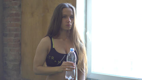 Fitness Sporty Girl Drinking A Water Footage