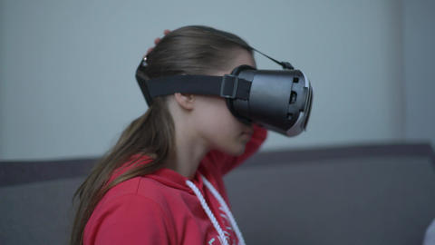 Young Woman Wearing Vr Headset And Experiencing Virtual Reality Footage