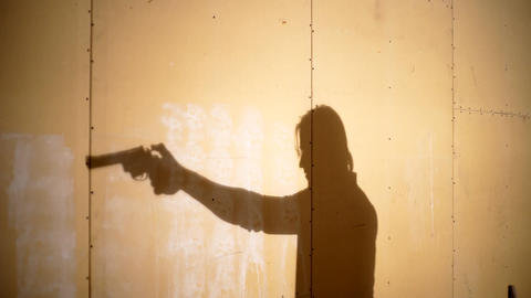 Silhouette Of Man Gun Shooting Footage