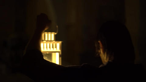 The Murderer Killer In A Dark Room. Goes With A Candlestick And Looks Around Live Action