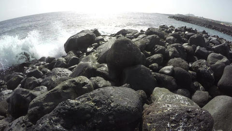 Waves on ocean shore in Tenerife on sunny day, time lapse 4K Footage
