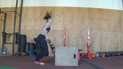 Slow Motion Girl Training In Crossfit Gym. Jumping On The Box Footage