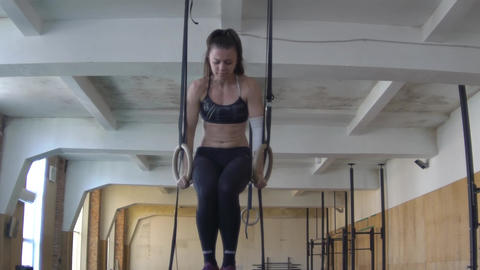 Woman Doing Pull-Ups In A Gym On Gymnastic Rings Footage