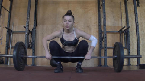 Female Athlete Barbell Clean and Jerk At Crossfit Competition Slow Motion Footage