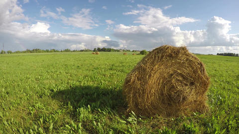 Haystacks in the meadow, time lapse 4K Footage