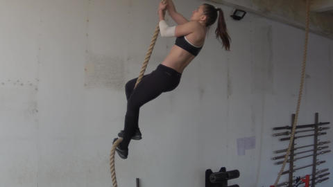 Crossfit Woman Doing Rope Climb. Climbing Footage