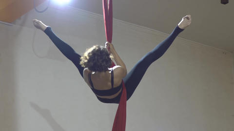 Slow Motion Pretty Woman - Aerialist Doing Acrobatic Tricks On Aerial Silks Footage