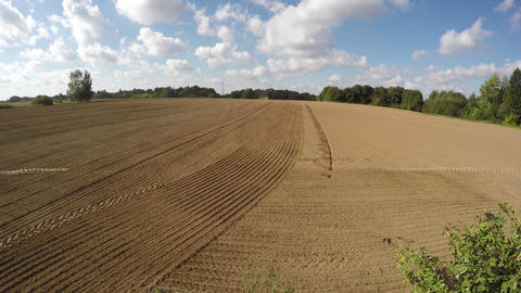 ractor sowing seeds in the clay soil field, time lapse 4K Footage