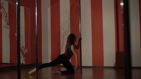 Professional Pole Dance. Young Beautiful Woman Performs Sensual Dance Footage