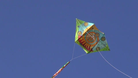 Handmade multicolored kite flying high in the sky Footage