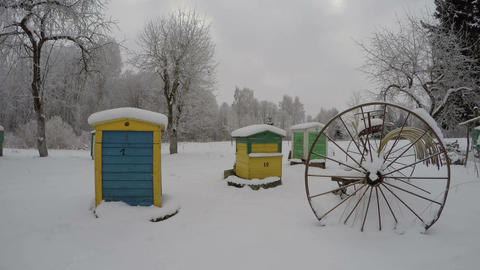 beehives in winter and vintage horse rake agriculture tool, time lapse 4K Footage