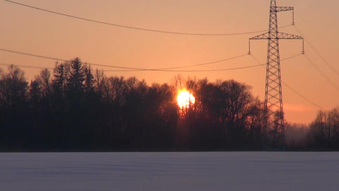 Landscape with electrical pylon in winter's evening Footage
