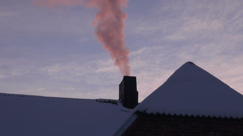 Pink smoke coming from house chimney Footage