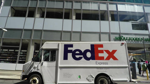 New York, USA A FedEx van delivering packages parked in a street Footage
