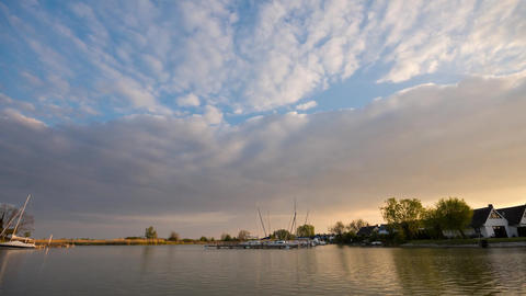 Time-lapse of sunset sky at Neusiedlersee (Lake Neusiedl) in Austria Footage
