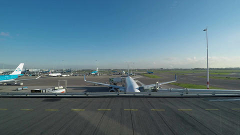 Amsterdam, Netherlands Aircrafts taxiing on runway at Schiphol Live Action