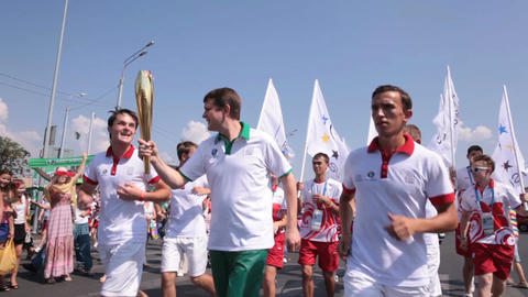 Competition Participants Run with Olympic Fire between People Footage