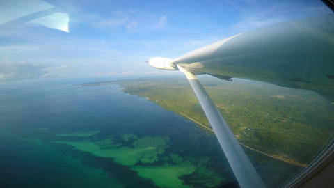 Flying single-engine aircraft over Tanzania. Africa Live Action