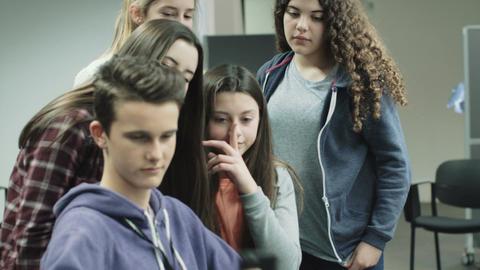 Teenage girls and boy making selfie on smart phone Footage