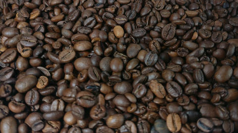 Falling and rotation roasted coffee beans Footage