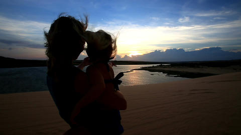 Closeup Silhouette Mother Holds Small Girl Photos Lake at Sunset Footage