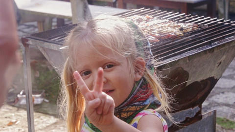 Blonde Little Girl Poses to Daddy and Shows Peace and Doll Footage