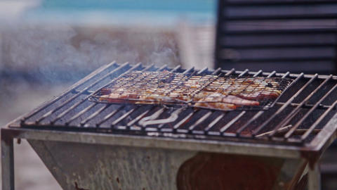 Meat Piece Roasts on Fire on Metal Barbecue Grid Footage