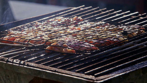 Closeup Somebody Roasts Meat on Open Fire on Barbecue Grid Footage