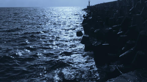 Waves at a Breakwater at Dawn. Slow Motion Footage