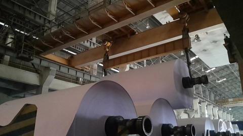 Paper Reel being carried overhead