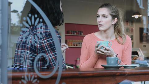 Female friends talking in coffee shop Footage