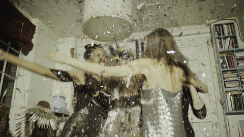Pretty young adult women dancing with confetti Footage