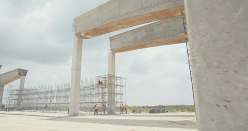 Large highway construction site with workers and heavy construction tools Footage