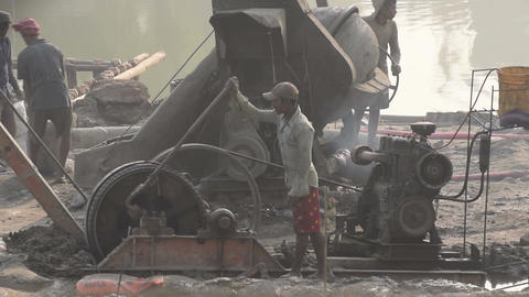 Indian labours working at a project site with diesel generator Footage