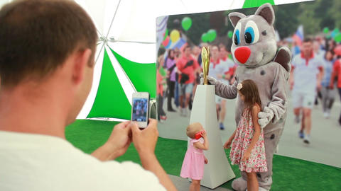 Little Girl Poses with Animator in Cat Costume to Father Footage