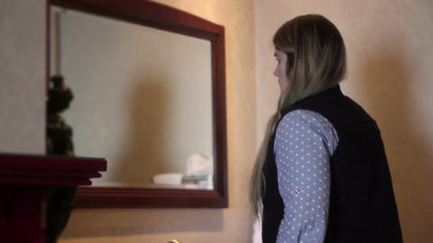 Woman checks out herself in luxurious hotel bathroom Footage
