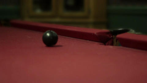 Cue ball sinks the black eightball at pool table in bar Live Action