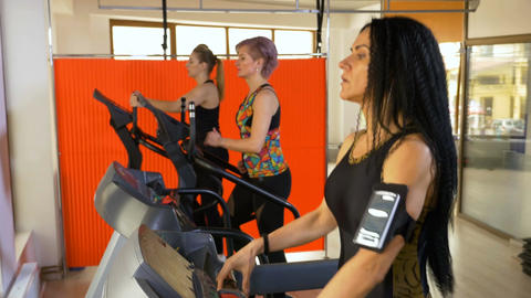 Fitness instructor training on the treadmill setting up smartphone tracking app Footage